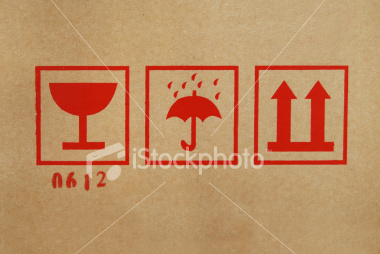 ist2_3947909-shipping-icons-on-cardboard-box